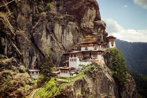 In Bhutan's Paro Valley, the stunning Tigers Nest Monastery perches on a mountain cliff.