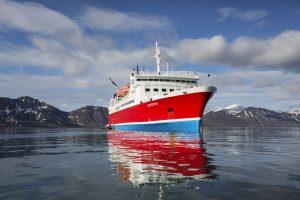 G Adventures' G Expedition ship, in dark crystal Arctic seas. © G Adventures, Inc.